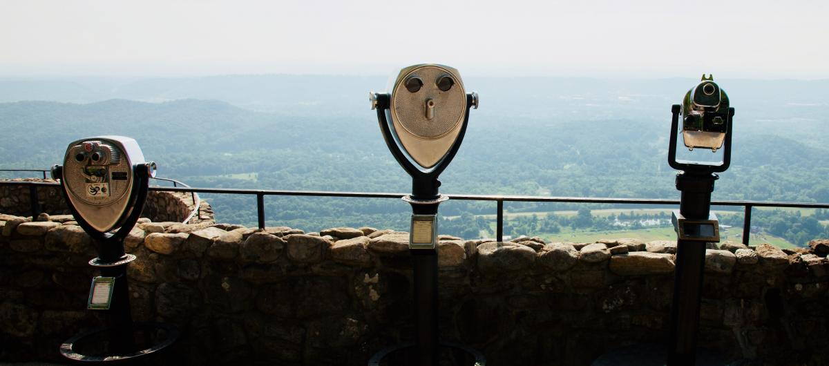 Binoculars on overlook of mountain